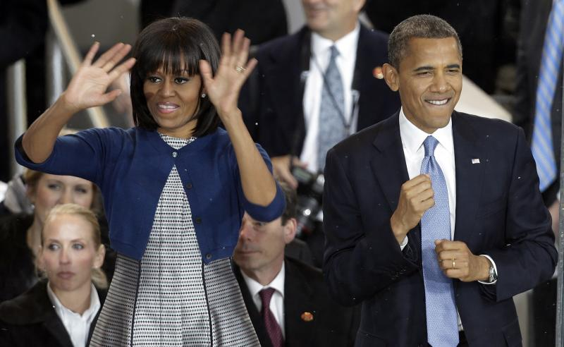 President Barack Obama dances with first lady Michelle Obama in the presidential box during the Inaugural parade Monday, Jan. 21, 2013, in Washington. Thousands marched during the 57th Presidential Inauguration parade after the ceremonial swearing-in of President Barack Obama. (AP Photo/Gerald Herbert)