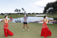 Lydia Ko, of New Zealand, center, performs a hula dance after winning the Lotte Championship golf tournament, Saturday, April 17, 2021, in Kapolei, Hawaii. (AP Photo/Marco Garcia)