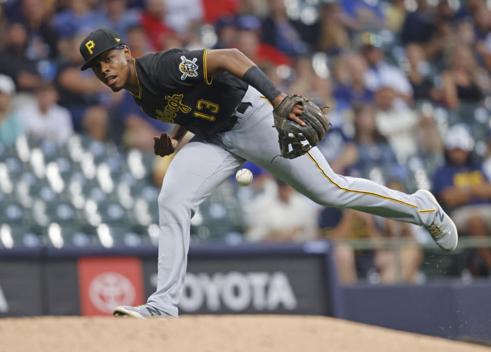 Pittsburgh Pirates third baseman Ke'Bryan Hayes bobbles a ball hit by Milwaukee Brewers' Lorenzo Cain during the third inning of a baseball game Monday, Aug. 2, 2021, in Milwaukee. (AP Photo/Jeffrey Phelps)