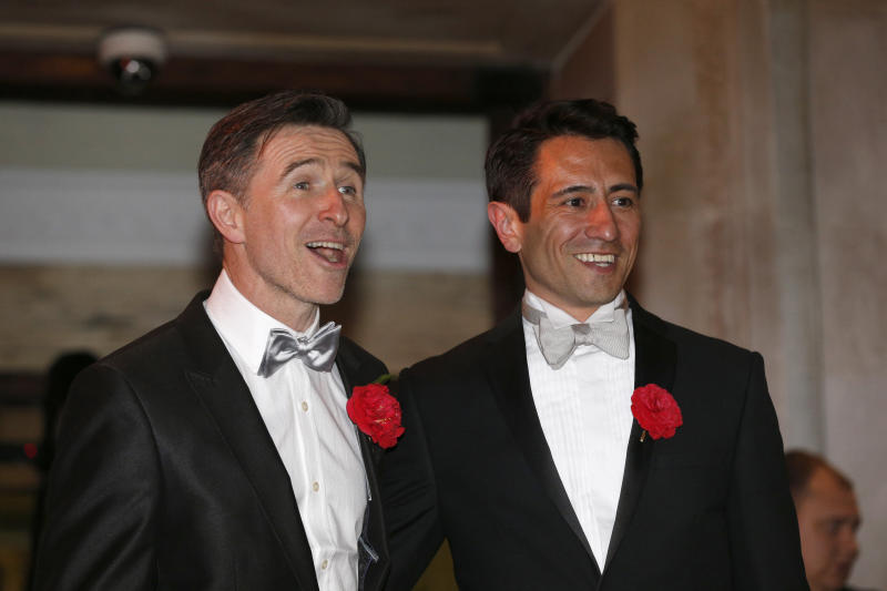 Peter McGraith and David Cabreza after their wedding at Islington Town Hall, one of the first same sex couples to wed in England and Wales (PA Archive/PA Images)