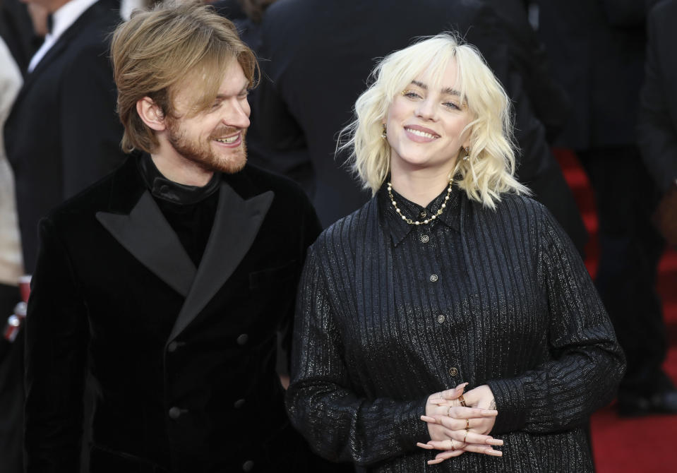 Finneas O'Connell, left, and Billie Eilish pose for photographers upon arrival for the World premiere of the new film from the James Bond franchise 'No Time To Die', in London Tuesday, Sept. 28, 2021. (Photo by Vianney Le Caer/Invision/AP)