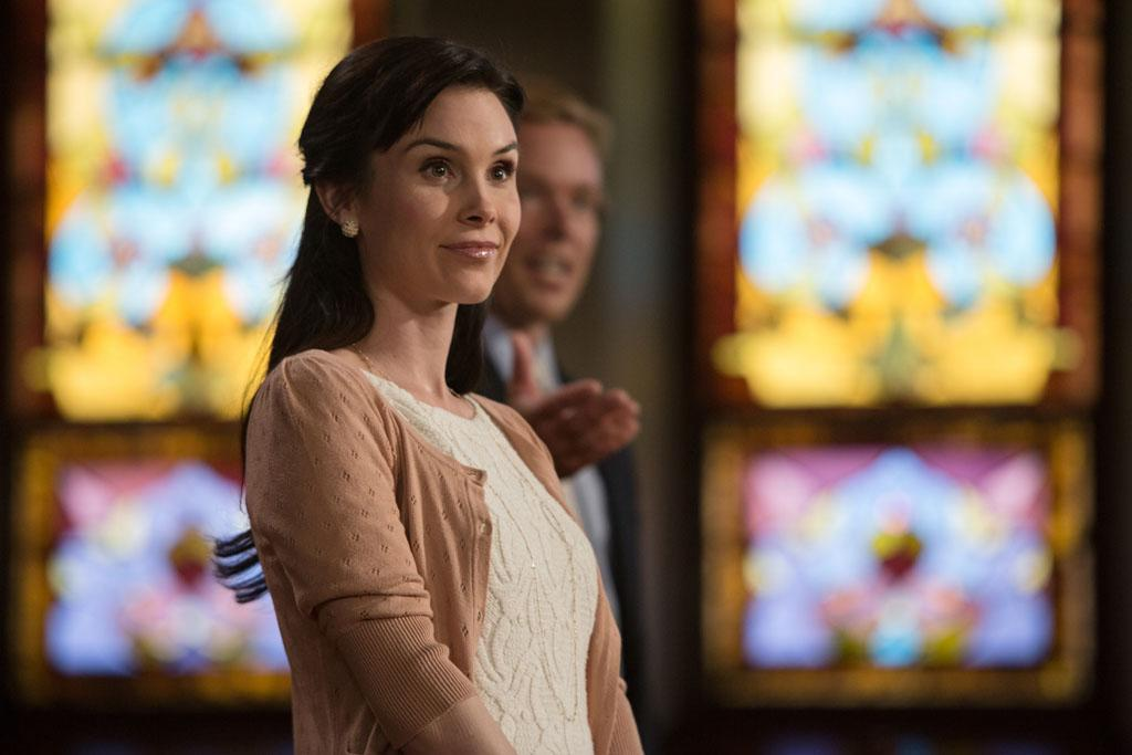"Kristina Anapau as Megan and Jonathan Scarfe as Reverand Calvin in the ""Grimm"" episode, ""The Good Shepherd."""