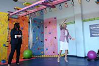 <p>The First Lady paired a pink tweed blazer with a white dress and pink pumps to tour Benjamin Franklin Elementary School in Meriden, Connecticut.</p>
