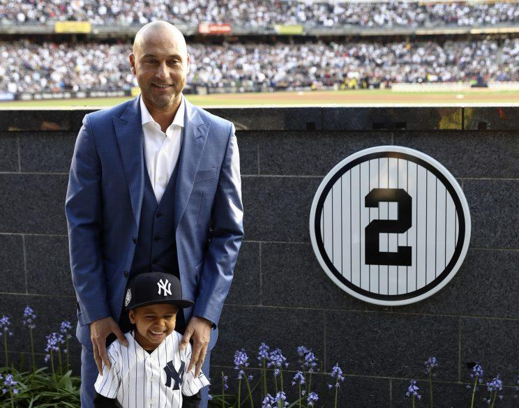 Retired New York Yankees shortstop Derek Jeter poses with his nephew Jalen Jeter during a pregame ceremony retiring his number 2 in Monument Park at Yankee Stadium in New York, Sunday, May 14, 2017. (AP Photo/Elsa, Pool)