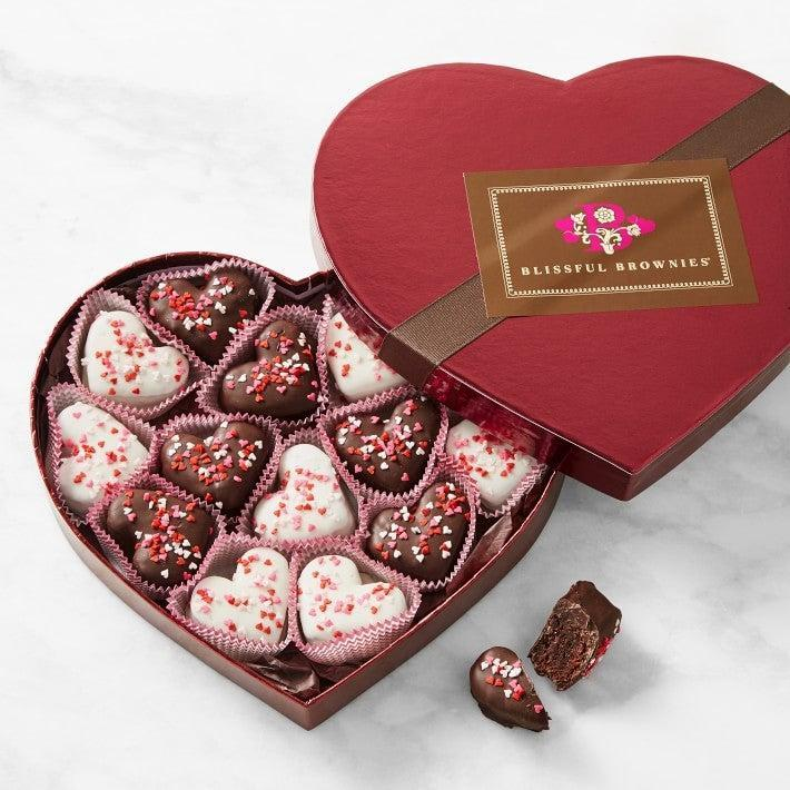 "<h2>Williams Sonoma Valentine's Day Brownie Bites</h2><br>If chocolate truffles aren't your thing, why not try chocolate-dipped brownie bites? <br><br><em>Shop</em> <strong><em><a href=""https://www.williams-sonoma.com/"" rel=""nofollow noopener"" target=""_blank"" data-ylk=""slk:Williams Sonoma"" class=""link rapid-noclick-resp"">Williams Sonoma</a></em></strong><br><br><strong>Williams Sonoma</strong> Valentine's Day Brownie Bites, $, available at <a href=""https://go.skimresources.com/?id=30283X879131&url=https%3A%2F%2Fwww.williams-sonoma.com%2Fproducts%2Fvalentines-day-brownie-bites"" rel=""nofollow noopener"" target=""_blank"" data-ylk=""slk:Williams Sonoma"" class=""link rapid-noclick-resp"">Williams Sonoma</a>"