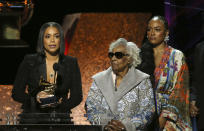 "Lauren London, from left, Margaret Boutte, and Samantha Smith accept the award for best rap performance for ""Racks in the Middle"" on behalf of Nipsey Hussle at the 62nd annual Grammy Awards on Sunday, Jan. 26, 2020, in Los Angeles. (Photo by Matt Sayles/Invision/AP)"