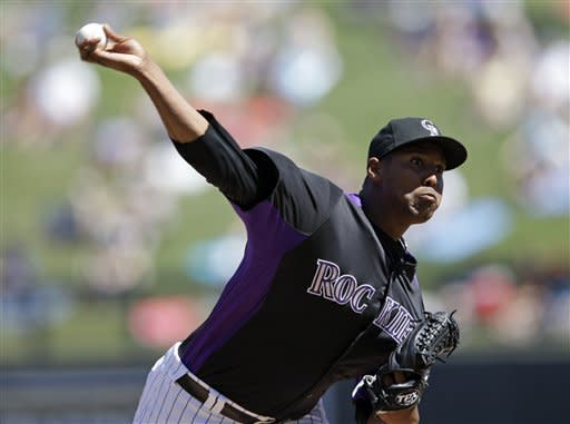 Colorado Rockies starting pitcher Juan Nicasio throws to the Seattle Mariners during the third inning of a spring training baseball game on Tuesday, April 3, 2012 in Scottsdale, Ariz. (AP Photo/Marcio Jose Sanchez)