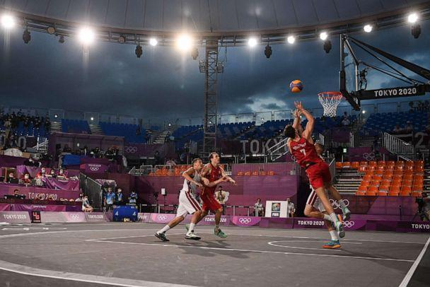 PHOTO: Belgium's Rafael Bogaerts jumps to score during the men's first round 3x3 basketball match between Latvia and Belgium at the Aomi Urban Sports Park in Tokyo, on July 24, 2021 during the Tokyo 2020 Olympic Games. (Andrej Isakovic/AFP via Getty Images)