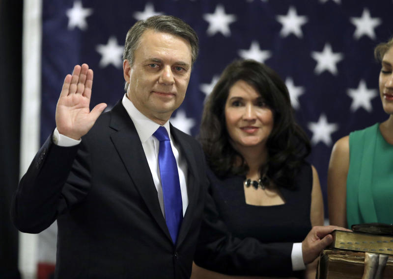 "FILE - In this Jan. 31, 2018 file photo, Republican Jeff Colyer is sworn in as the 47th governor of Kansas during a ceremony at the Statehouse in Topeka, Kan. In February, Colyer announced an executive order that requires his staff to use official email accounts for all government business. He also banned private accounts for any communications related to ""the functions, activities, programs, or operations"" of the office. (AP Photo/Orlin Wagner, File)"