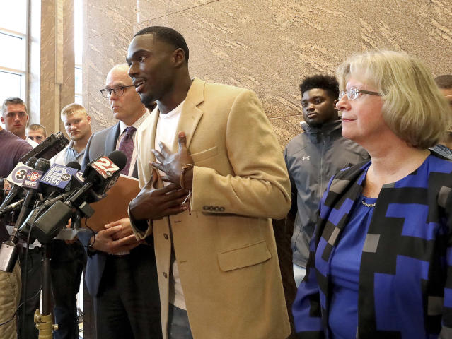 FILE - In this Aug. 12, 2019, file photo, former Wisconsin NCAA college football player Quintez Cephus speaks during a press conference to reiterate his request for reinstatement to the university, in Madison, Wis. Less than four months ago, football was gone, and all Cephus had was his faith and his family. (John Hart/Wisconsin State Journal via AP)