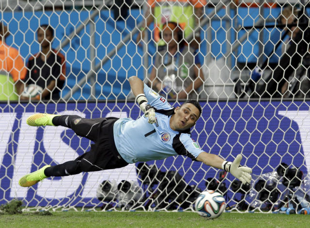 Costa Rica's goalkeeper Keylor Navas dives trying to save a penalty kick during penalty kicks at the World Cup quarterfinal soccer match between the Netherlands and Costa Rica at the Arena Fonte Nova in Salvador, Brazil, Saturday, July 5, 2014. The Netherlands won 4-3 on penalty kicks