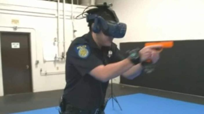 In the simulator as part of their training, Sacramento Police officers wear a headset and sensors that track their arm movements, as well as how they use weapons like pistols and tasers. (CNN)
