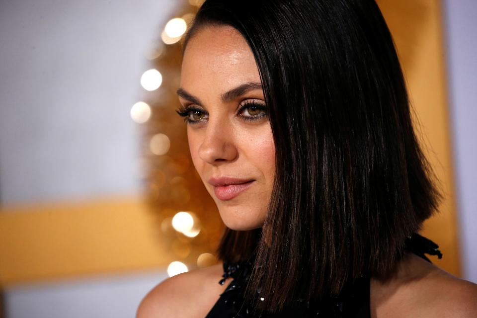 Cast member Mila Kunis poses at the premiere for