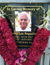 In this photo provided by the Rev. Cedric Prakash, a plaque memorializes the Rev. Jerry Sequeira, who died from the coronavirus on April 18, 2021, in Ahmedabad, India. (Cedric Prakash via AP)