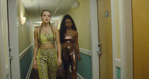 """This image released by A24 shows Riley Keough, left, and Taylour Paige in a scene from """"Zola."""" (A24 Films via AP)"""