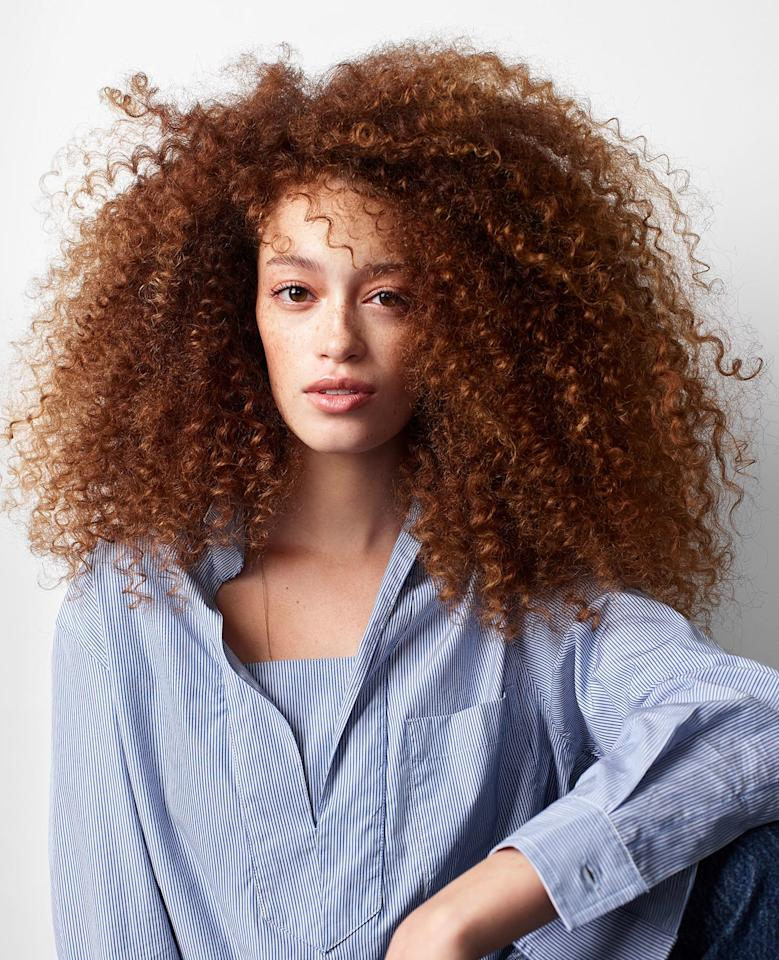"""<p>""""Women are embracing their texture more because they are seeing more representation of what they look like in the media,"""" says Redway.</p> <p>Long layers give Emma's thick, coarse hair some shape. Redway applied Jane Carter Solution Nourish and Shine Butter Cream ($12; <a href=""""http://goto.target.com/c/249354/81938/2092?subId1=RS%2CEasyStylesforEveryKindofCurlyHair%2Ceisenhat%2CHAI%2CIMA%2C669317%2C201907%2CI&u=https%3A%2F%2Fwww.target.com%2Fp%2Fjane-carter-solution-nourish-and-shine-4-fl-oz%2F-%2FA-12236774"""" target=""""_blank"""">target.com</a>) before diffusing her hair. She wrapped a few pieces around an eighth-inch curling iron for a more uniform look.</p>"""