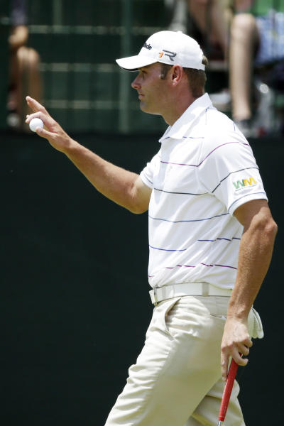 Shawn Stefani reacts after putting on the second hole during the third round of the U.S. Open golf tournament at Merion Golf Club, Saturday, June 15, 2013, in Ardmore, Pa. (AP Photo/Gene J. Puskar)