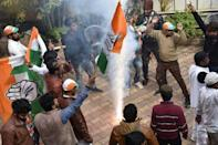 Congress-JMM alliance workers in Ranchi celebrate results projecting an assembly majority in the Jharkhand state election -- bringing more bad news for Prime Minister Narendra Modi