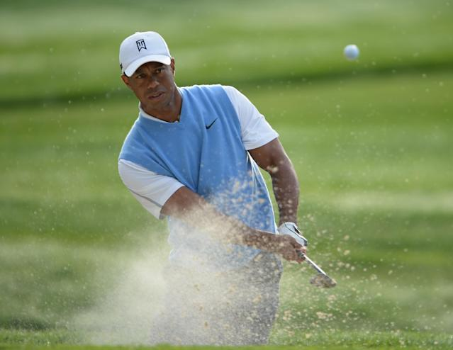 ROCHESTER, NY - AUGUST 06: Tiger Woods of the United States plays a shot from a bunker during a practice round prior to the start of the 95th PGA Championship at Oak Hill Country Club on August 6, 2013 in Rochester, New York. (Photo by Stuart Franklin/Getty Images)