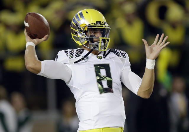 Oregon quarterback Marcus Mariota warms up before an NCAA college football game against Stanford, Thursday, Nov. 7, 2013, in Stanford, Calif. (AP Photo/Marcio Jose Sanchez)