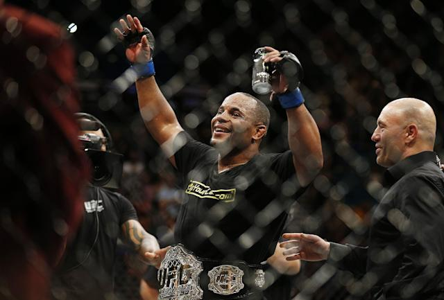 Daniel Cormier celebrates after defeating Anthony Johnson at UFC 187. (AP)