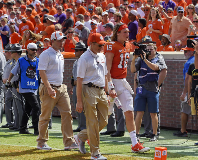 Clemson quarterback Trevor Lawrence leaves the field after being injured during the first half of an NCAA college football game against Syracuse Saturday, Sept. 29, 2018, in Clemson, S.C. (AP Photo/Richard Shiro)