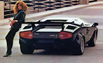 """<p>Any car-loving child of the '80s either owned, or had a friend who owned, a Countach poster on the wall. Why? Because the car epitomized cool. Its doors opened like no other vehicle's on the planet. In fact, this Lambo's true scissor door—which swings up on one plane, in contrast to the more common dihedral door that also swings out—was so iconic that only the Bugatti EB110 and Vector W8 dared to imitate it. Power from the V-12 engine, which ranged from a 370-hp 3.9-liter in 1978 to a 445-hp 5.2-liter in the mid-'80s, was always routed through a five-speed manual. It <a href=""""http://www.caranddriver.com/reviews/1983-lamborghini-countach-5000s-road-test-review"""" rel=""""nofollow noopener"""" target=""""_blank"""" data-ylk=""""slk:was a beast"""" class=""""link rapid-noclick-resp"""">was a beast</a>.<br><br></p>"""
