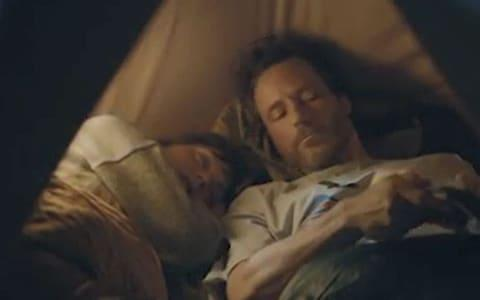 A Volkwagen advert showed a man and a woman asleep in a tent next to a cliff face - Credit: ASA/PA
