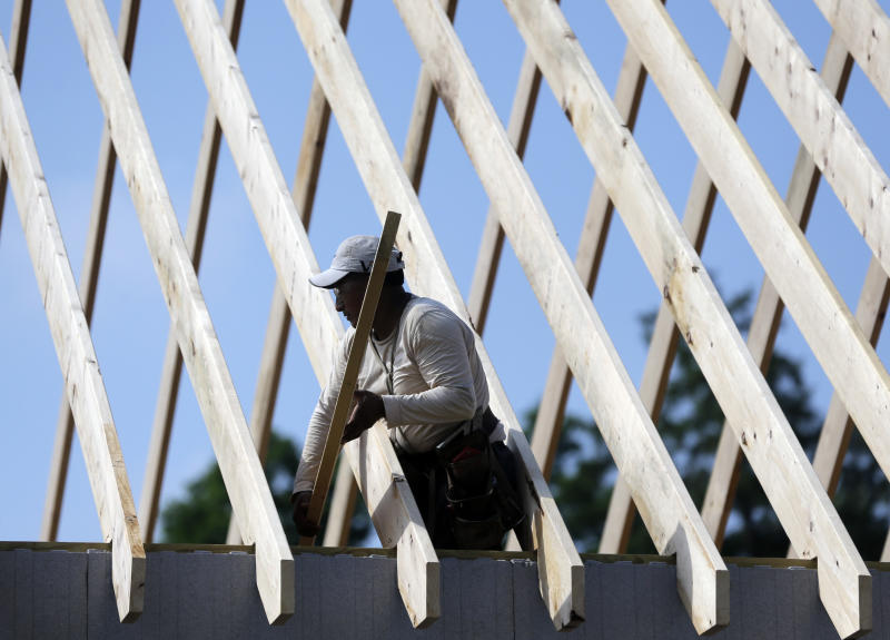A worker works on the roof of a zero net energy home at The Preserve at Mountain Vista on Tuesday, July 9, 2013, in New Paltz, N.Y. (AP Photo/Mike Groll)