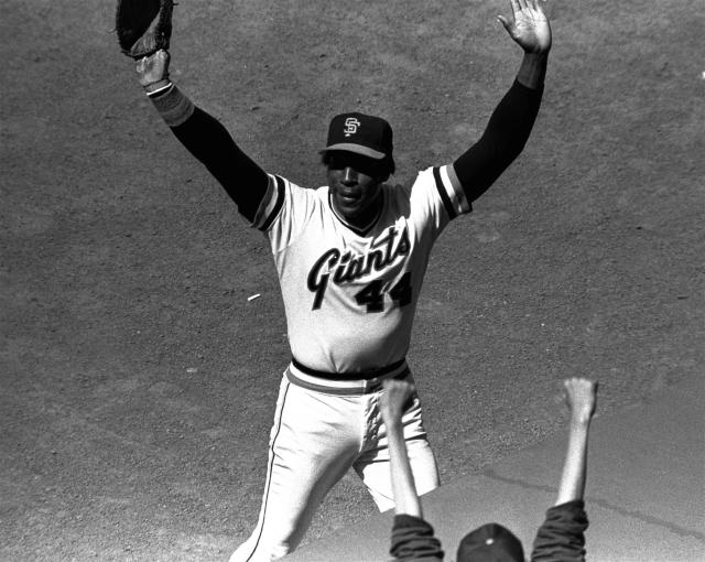 "FILE - In this July 3, 1980, file photo, San Francisco Giants' Willie McCovey raises his hands in salute to the cheering crowd after he was replaced in the lineup in the team's baseball game with the Cincinnati Reds in San Francisco. It was the last home appearance before retirement for the popular veteran. McCovey, the sweet-swinging Hall of Famer nicknamed ""Stretch"" for his 6-foot-4 height and those long arms, has died. He was 80. The San Francisco Giants announced his death, saying the fearsome hitter passed peacefully Wednesday afternoon, Oct. 31, 2018, after losing his battle with ongoing health issues. (AP Photo/Robert Houston, File)"