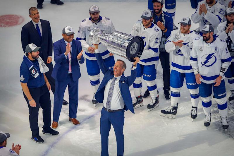 Tampa Bay Lightning head coach Jon Cooper hoists the Stanley Cup after the Lightning defeat the Dallas Stars in game six of the 2020 Stanley Cup Final at Rogers Place.