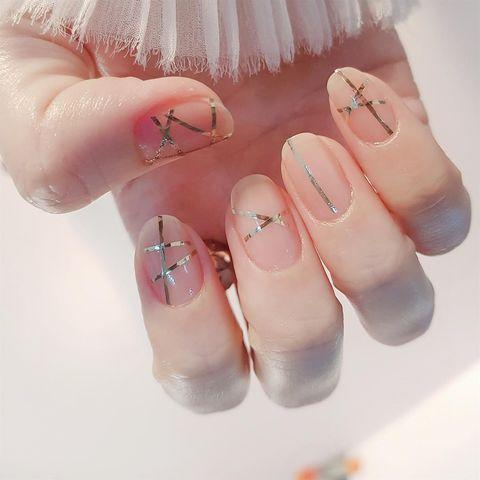 """<p>We love this intricate nail design using strips of nail foil over a neutral pink base. </p><p><a href=""""https://www.instagram.com/p/BpM_pB5nKPY/"""" rel=""""nofollow noopener"""" target=""""_blank"""" data-ylk=""""slk:See the original post on Instagram"""" class=""""link rapid-noclick-resp"""">See the original post on Instagram</a></p>"""