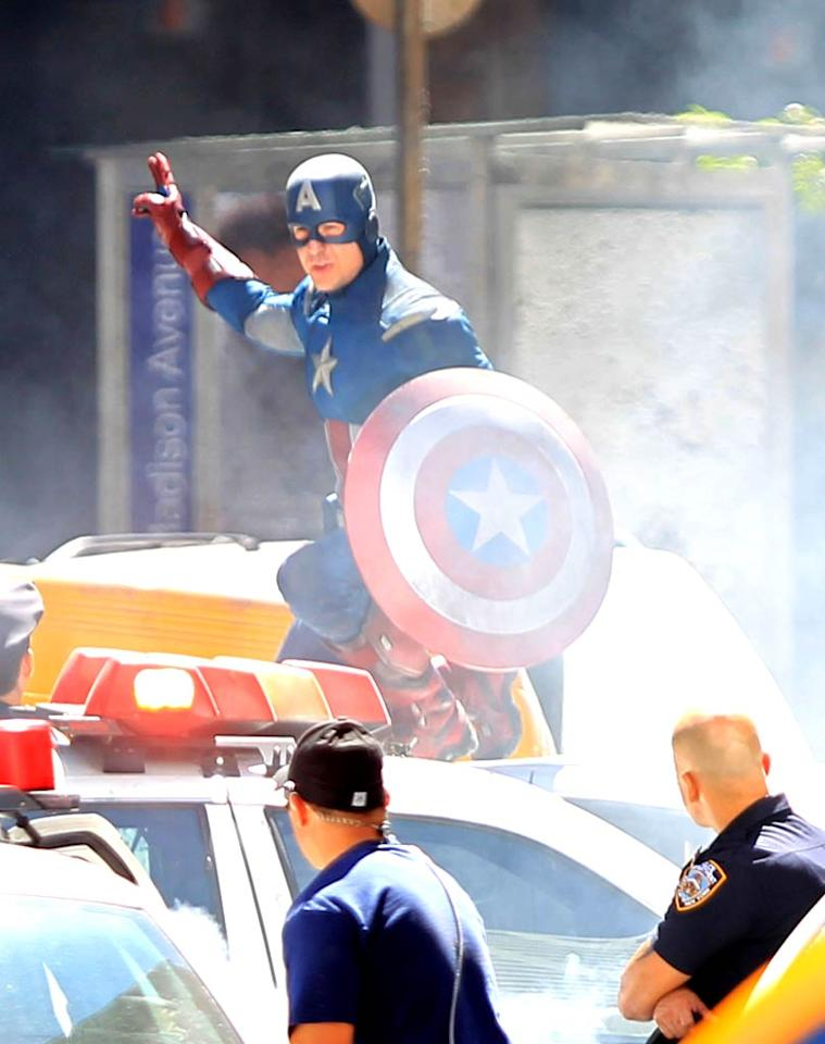 """Chris Evans was back to saving lives on Tuesday while filming the """"Captain America"""" sequel. Though this particular scene is <i>supposed</i> to take place in Midtown Manhattan, the set is actually in Cleveland. Let's just say we're not envious of Chris, who had to wear that costume in the middle of a hot Ohio summer! Turgeon/Prahl/<a href=""""http://www.splashnewsonline.com"""" target=""""new"""">Splash News</a> - August 16, 2011"""