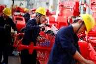 Employees work at a manufacturing plant of Sany Heavy Industry Co. during a government-organised tour of manufacturers based in Changsha, Hunan province, China, October 19, 2019. REUTERS/Thomas Peter??