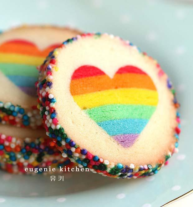 """<p>Definitely a welcome change from all the pink and red going on. <i>[Photo: <a href=""""http://eugeniekitchen.com/rainbow-heart-cookies-eugenie/"""">Eugenie Kitchen</a>]</i></p>"""