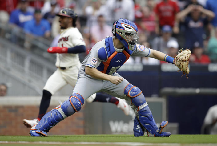 New York Mets catcher Patrick Mazeika waits for the ball as Atlanta Braves' Ozzie Albies scores behind him in the first inning of a baseball game Sunday, Oct. 3, 2021, in Atlanta. (AP Photo/Ben Margot)
