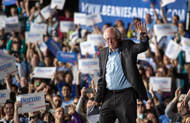 US Senator Bernie Sanders waves to the crowd before delivering remarks during a campaign rally in Manassas, Virginia on September 14, 2014 (AFP Photo/Paul J. Richards)