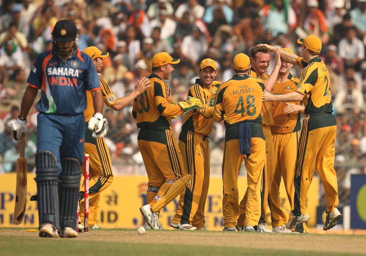 GUWAHATI, INDIA - NOVEMBER 08:  Doug Bollinger of Australia celebrates with his team mates after taking the wicket of Yuvraj Singh of India  during the sixth One Day International match between India and Australia at Jawaharlal Nehru Stadium on November 8, 2009 in Guwahati, India.  (Photo by Mark Kolbe/Getty Images)