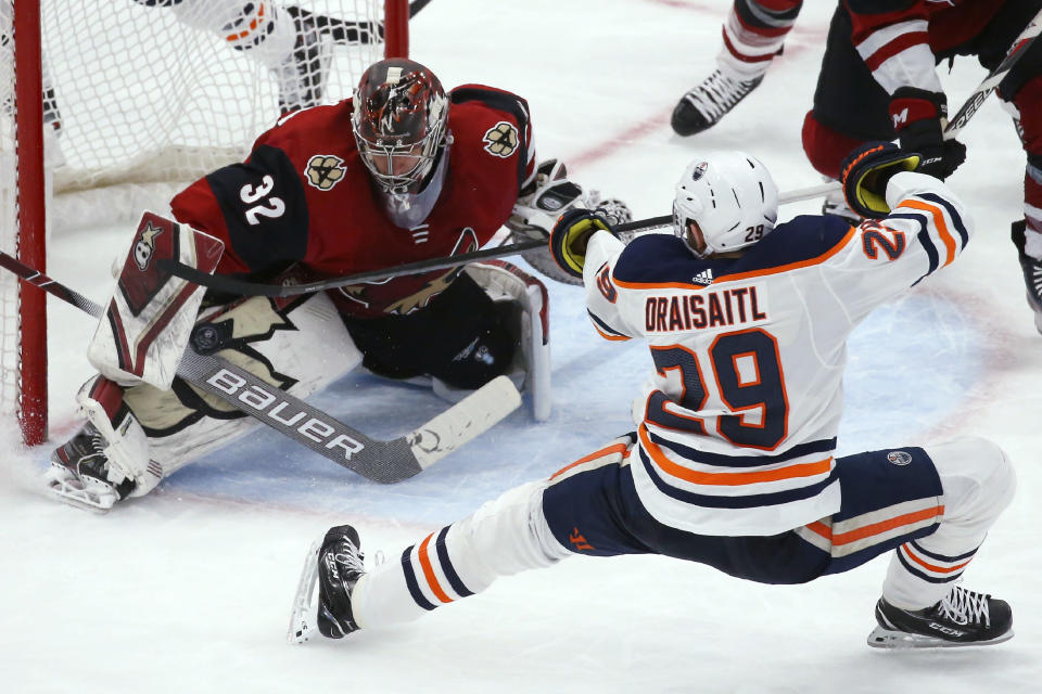 Arizona Coyotes goaltender Antti Raanta (32) makes a save on a shot by Edmonton Oilers center Leon Draisaitl (29) during the third period of an NHL hockey game Tuesday, Feb. 4, 2020, in Glendale, Ariz. The Coyotes won 3-0. (AP Photo/Ross D. Franklin)