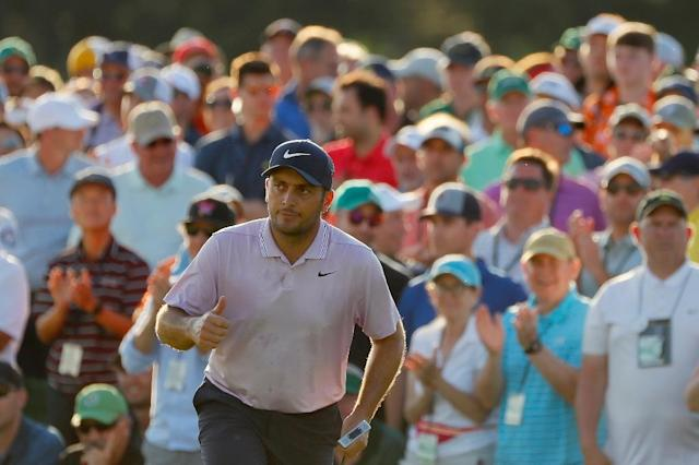 Third-round leader: Italy's Francesco Molinari of Italy acknowledges fans at the 18th green on the way to his third-round 66 in the Masters at Augusta National (AFP Photo/Kevin C. Cox)