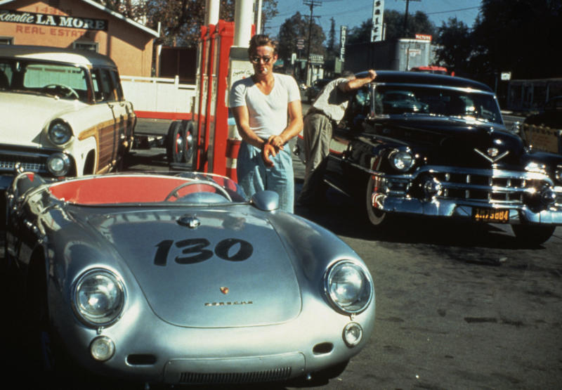 James Dean at a gas station with his silver Porsche 550 Spyder he named Little Bastard, just hours before his fatal crash.