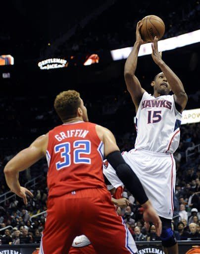Atlanta Hawks' Al Horford (15) goes up over Los Angeles Clippers' Blake Griffin (32) in the first half of an NBA basketball game at Philips Arena in Atlanta, Saturday, Nov. 24, 2012. (AP Photo/David Tulis)