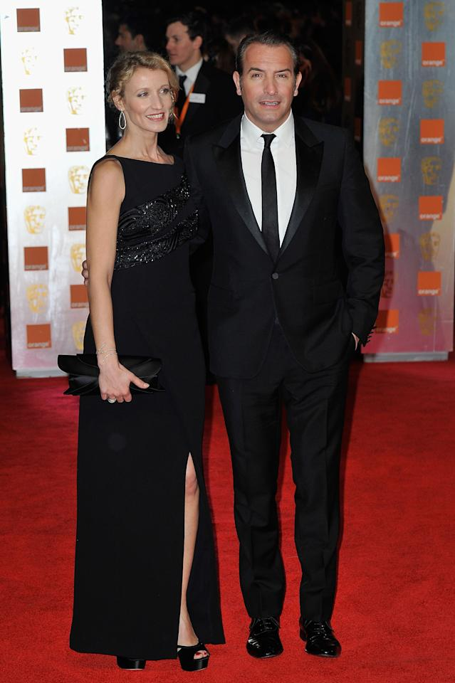 LONDON, ENGLAND - FEBRUARY 12:  Actor Jean Dujardin and Alexandra Lamy attend the Orange British Academy Film Awards 2012 at the Royal Opera House on February 12, 2012 in London, England.  (Photo by Gareth Cattermole/Getty Images)