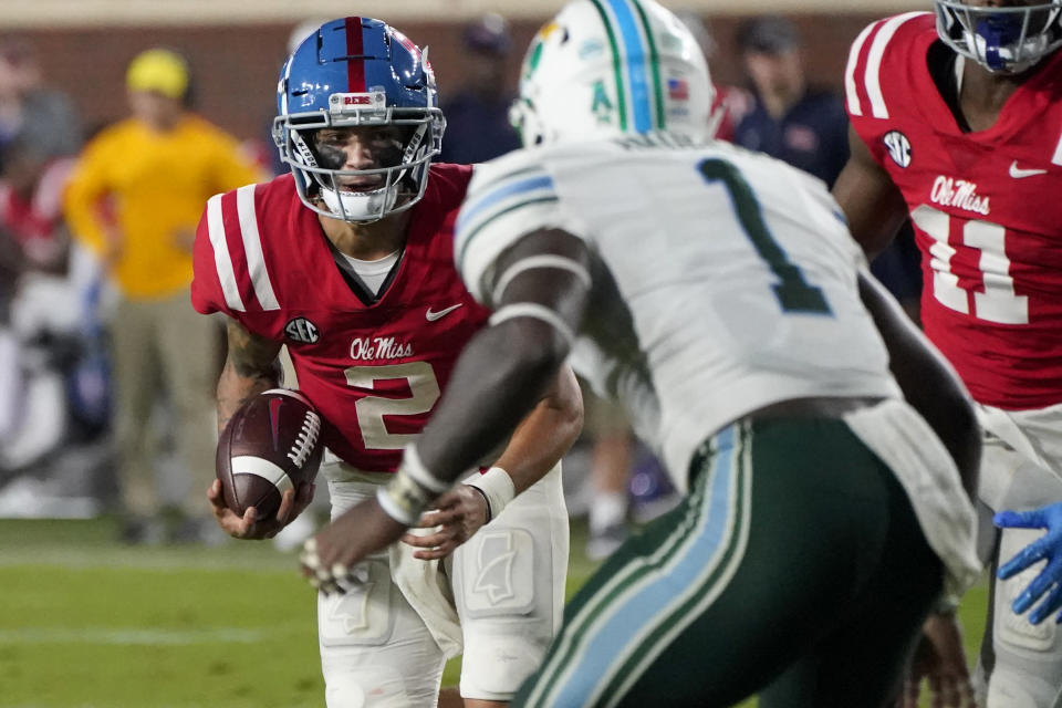 Mississippi quarterback Matt Corral (2) tries to run past Tulane linebacker Nick Anderson (1) during the first half of an NCAA college football game, Saturday, Sept. 18, 2021, in Oxford, Miss. (AP Photo/Rogelio V. Solis)