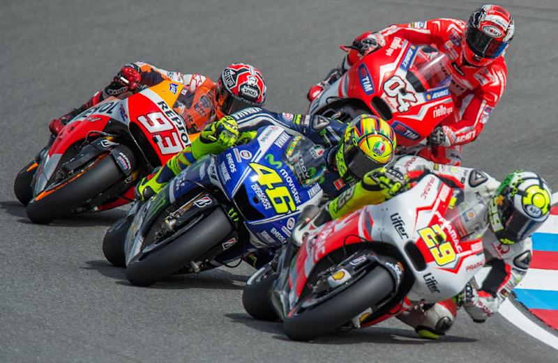 Pramac Racing Team's Italian rider Andrea Iannone (front) is followed by Yamaha Factory MotoGP's Italian rider Valentino Rossi on August 17, 2014 in Brno, Czech Republic (AFP Photo/Joe Klamar )