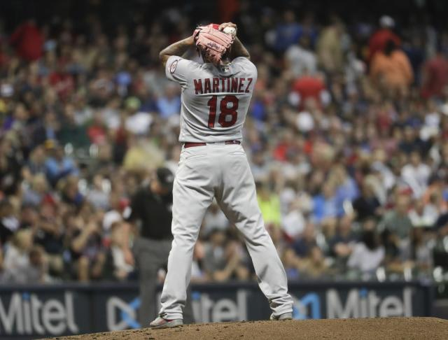 St. Louis Cardinals starting pitcher Carlos Martinez reacts after throwing a wild pitch to allow a run during the third inning of a baseball game against the Milwaukee Brewers Thursday, June 21, 2018, in Milwaukee. (AP Photo/Morry Gash)