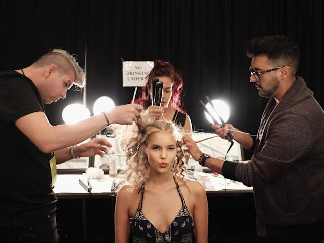 A model is prepared backstage at the Sun Jung Wan fashion show during New York Fashion Week: The Shows at The Dock, Skylight, at Moynihan Station on Sept. 10, 2016, in New York City. (Photo: Getty Images)
