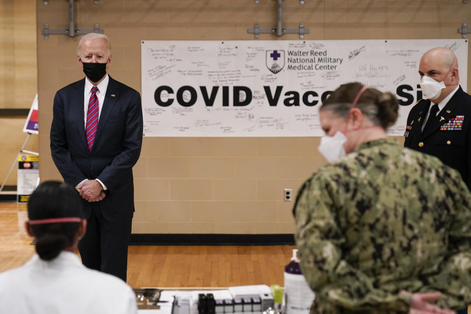 President Joe Biden tours the COVID-19 vaccine center at Walter Reed National Military Medical Center, Friday, Jan. 29, 2021, in Bethesda, Md. (AP Photo/Alex Brandon)