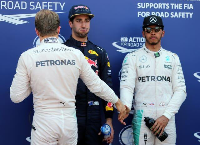Lewis Hamilton shakes hands with former team-mate Nico Rosberg, with whom he endured a fractious relationship