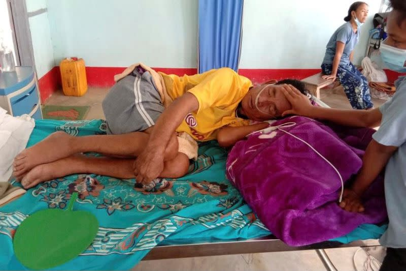 A COVID-19 patient lies in bed at the hospital in Cikha
